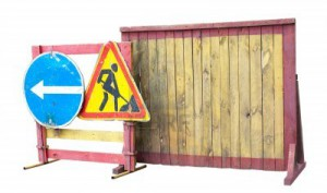 10313294-road-closed-sign-before-the-road-construction--men-at-work-isolated-on-white-background